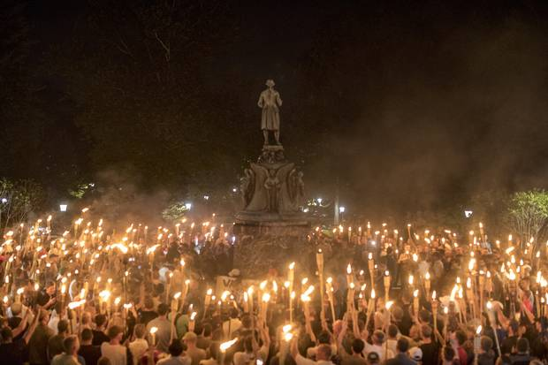 Torch-bearing white nationalists rally around a statue of Thomas Jefferson near the University of Virginia campus in Charlottesville, Aug. 11, 2017.