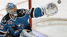 San Jose Sharks goalie Evgeni Nabokov watches the puck sail past his glove against the Colorado Avalanche during the second period of Game 1 of their NHL Western Conference quarter-final hockey game in San Jose, California April 14, 2010. (ROBERT GALBRAITH/REUTERS)