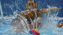 Australia's Glencora Ralph chases after the ball during their women's water polo quarterfinal round against China at the Water Polo Arena during the London 2012 Olympic Games August 5, 2012. (LASZLO BALOGH/REUTERS)