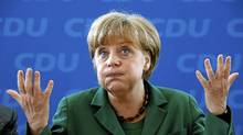 German Chancellor and Christian Democratic Union party leader Angela Merkel reacts before a party board meeting in Berlin, May 7, 2012. (Fabrizio Bensch/Reuters/Fabrizio Bensch/Reuters)