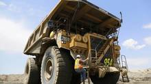 Jeff Wilsey, a Newmont Mining haul truck driver, climbs into his truck at Newmont's Carlin gold mine operation near Elko, Nevada May 22, 2014. The two-storey haul truck carries approximately 248 tons of material at a time. (RICK WILKING/REUTERS)