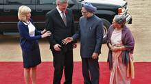 India's Prime Minister Manmohan Singh welcomes his Canadian counterpart Stephen Harper during a ceremonial reception at the forecourt of India's presidential palace Rashtrapati Bhavan, in New Delhi Nov. 6, 2012. At left is Mr. Harper's wife Laureen and Mr. Singh's wife Gursharan Kaur is at right. (B MATHUR/REUTERS)
