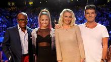 "This June 2012 photo released by FOX shows judges, from left, L.A. Reid, Demi Lovato, Britney Spears and Simon Cowell on the set of ""The X Factor."" The contest between ""The Voice"" and ""The X Factor"" is escalating after NBC scheduled its ""Voice"" against Wednesday's second-season debut of Fox's ""X Factor."" (Ray Mickshaw/AP)"