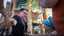 B.C. NDP Leader Adrian Dix presses the flesh on the streets of Kelowna on May 8, 2013. (John Lehmann/The Globe and Mail)