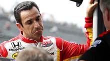 IndyCar driver Helio Castroneves of Brazil chats with his team members during the second practice for the Indy Japan auto race at Twin Ring Motegi in Motegi, northeast of Tokyo. Castroneves has lashed out at IndyCar chief steward Brian Barnhart after the Brazilian driver was penalized in Sunday's Indy Japan. (Shizuo Kambayashi/AP Photo/Shizuo Kambayashi, File)