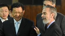 China's Trade Minister Chen Deming, left, and Brazil's Foreign Minister Antonio Patriota talk during a meeting at Itamaraty Palace in Brasilia this week. (EVARISTO SA/AFP/Getty Images)