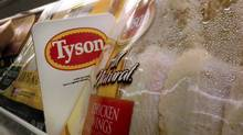 In this May 3, 2009 file photo, Tyson Foods chicken products are displayed on the shelves of a Little Rock, Ark. grocery store. (Danny Johnston/Danny Johnston/AP)