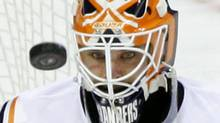 This This Dec. 8, 2009, file photo shows New York Islanders goalie Martin Biron watching the puck shot by Philadelphia Flyers' Jeff Carter in the third period of an NHL hockey game, in Philadelphia. Veteran goalie Martin Biron signed a two-year deal with the New York Rangers on Thursday, July 1, 2010, less than one hour into the NHL's free-agent shopping season. (AP Photo/Matt Slocum, File) (Matt Slocum/AP2009)