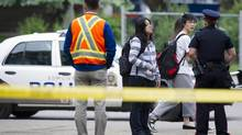 Students are turned away from the scene of a shooting in Edmonton on Friday, June 15, 2012. Three people are dead and one is in critical condition after a violent armoured car robbery early Friday at the University of Alberta campus. (Ian Jackson/THE CANADIAN PRESS)