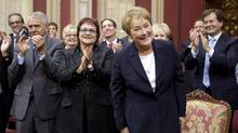 Premier-designate Pauline Marois smiles as members and people applaud her before she is sworn in as legislature member for Charlevoix–Côte-de-Beaupré with 53 other elected members are sworn in during a ceremony on Monday, Sept. 17, 2012. (Jacques Boissinot/THE CANADIAN PRESS)