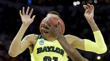 Baylor's Isaiah Austin has his face covered by the ball as Nebraska's Leslee Smith's arm reaches for the ball (David J. Phillip/AP)