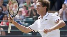 Filip Peliwo of Canada celebrates after defeating Luke Saville of Australia in their boys' singles tennis match at the Wimbledon Tennis Championships in London July 8, 2012. (STEFAN WERMUTH/REUTERS)