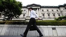 A man walks past the Bank of Japan headquarters in Tokyo June 15, 2012. (YURIKO NAKAO/REUTERS)