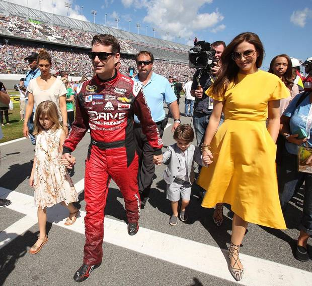 Jeff Gordon walks down pit road with wife Ingrid Vandebosch, daughter Ella and son Leo before the start of the Daytona 500.