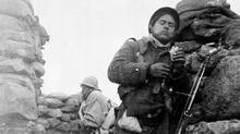 Spain; 1937-1938--Spanish Civil War-- Soldier of the Mackenzie-Papineau Batallion in a trench. ((CP PHOTO) 1999 (National Archives of Canada))