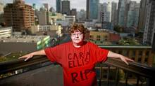 Lori-Ann Ellis wears a memorial t-shirt remembering her murdered sister-in-law Cara Ellis as she stands on the balcony of her Vancouver hotel room October 14, 2011. Ellis's sister-in-law Cara is one of convicted serial murderer Robert Pickton's victims. (Jeff Vinnick For The Globe and Mail)