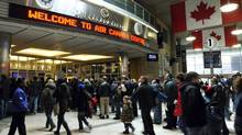 Fans enter the Air Canada Centre before the Toronto Raptors and Charlotte Bobcats NBA game in Toronto March 13, 2011. (MIKE CASSESE/REUTERS)