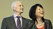NDP Leader Jack Layton and his wife, Toronto MP Olivia Chow, wait to be sworn in again in Ottawa after their re-election on May 18, 2011. (BLAIR GABLE/REUTERS)