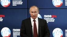 """Russia's President Vladimir Putin delivers a speech during the """"Oil and gas companies as an engine driving change in the world economy"""" session at the St. Petersburg International Economic Forum 2014 (SPIEF 2014) in St. Petersburg May 24. (SERGEI KARPUKHIN/REUTERS)"""