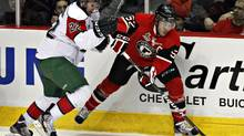 Halifax Mooseheads' Nathan MacKinnon, left, and Quebec Remparts' Mikael Tam battle for the puck during first period playoff action in Quebec City on Friday, April 6, 2012. (Jacques Boissinot/THE CANADIAN PRESS)