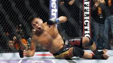 "Cung Le of Vietnam reacts after winning the middleweight match, of the Ultimate Fighting Championship UFC , after beating Rich ""Ace"" Franklin of the US, at the Venetian Macao, in Macau Sunday, Nov. 11, 2012. Cung Le won by a knock out in the first round. (Kin Cheung/AP)"