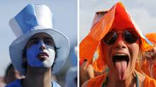 Argentine and Dutch soccer fans watch their respective teams at the 2014 World Cup in Brazil. (Reuters / AP)
