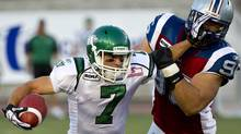 Saskatchewan Roughriders slotback Weston Dressler fends off Montreal Alouettes defensive tackle J.P. Bekasiak during second quarter CFL football action Sunday, July 24, 2011 in Montreal. The Roughriders won 27-24. (Paul Chiasson/The Canadian Press)