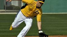 Pittsburgh Pirates' Russell Martin fields a grounder at shortstop (STEVE NESIUS/REUTERS)