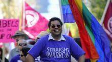 Calgary Mayor Naheed Nenshi leads the city's Gay Pride parade on Sept. 4, 2011. (Todd Korol for The Globea and Mail/Todd Korol for The Globea and Mail)
