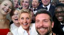 Oscars host Ellen DeGeneres takes a selfie with Jared Leto, Meryl Streep, Brad Pitt, Bradley Copper, and others. (AP Video)