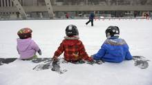 From left, eighteen month Faye James, Olivia Akiyama 3, and Greta James, 3 (Faye's sister) take a short break while skating at Nathan Phillip Square during an outing with their p