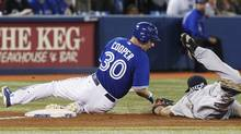 Toronto Blue Jays David Cooper is out at third base after being tagged by Boston Red Sox Kevin Youkilis during the fifth inning of their MLB American League baseball game in Toronto, June 3, 2012.   (Reuters)