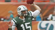New York Jets quarterback Tim Tebow warms up before his team met the Miami Dolphins in their NFL game in Miami, Florida September 23, 2012. (JOE SKIPPER/REUTERS)