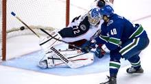 Vancouver Canucks' Maxim Lapierre (40) sends a shot past Columbus Blue Jackets goalie Sergei Bobrovsky (72) in a shootout during NHL action in Vancouver, B.C. Tuesday, March 26, 2013. (JONATHAN HAYWARD/THE CANADIAN PRESS)