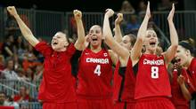 Members of Canada's team celebrate victory against Brazil after their women's preliminary round Group B basketball match at the Basketball Arena during the London 2012 Olympic Games August 3, 2012. (Reuters)