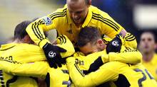 Columbus Crew players celebrate forward Federico Higuain's (33) goal against Toronto FC during the first half of their MLS soccer match, Sunday, Oct. 28, 2012, in Columbus, Ohio. Columbus won 2-1. (Eamon Queeney/The Associated Press)