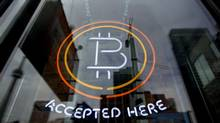 Photos of the signage in front of a three storey office on Spadina Ave. in Toronto, Ont. on Jan. 6, 2014. The signs have only recently gone up in the still-empty offices advertising bitcoin decentral. (Peter Power/The Globe and Mail)