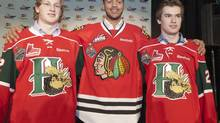 Halifax Mooseheads centre Nathan MacKinnon, left, Portland Winterhawks defenceman Seth Jones, centre, and Halifax Mooseheads left winger Jonathan Drouin pose for a photograph for the media in Saskatoon, Sask. on Thursday, May 16, 2013. The three players have been listed by NHL Central Scouting as potential first round selections in their Final Rankings for the 2013 NHL Draft. (Liam Richards/THE CANADIAN PRESS)