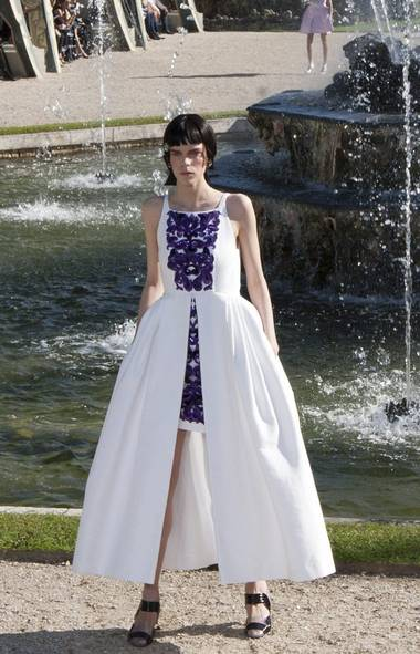 Guests donning enough Chanel to fill a museum show entered the palace grounds to an arrangement of cabanas placed around a grand fountain that spouted and burbled with gusto. Tilda Swinton, Vanessa Paradis and Vogue's André Leon Talley were some of the recognizable faces among international clients and editors. (Jacques Brinon / AP/Jacques Brinon / AP)