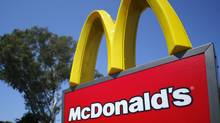 A McDonald's sign is shown at the entrance to one of the company's restaurants in Del Mar, Calif., in this Sept. 10, 2012, file photo.  (Mike Blake/Reuters)