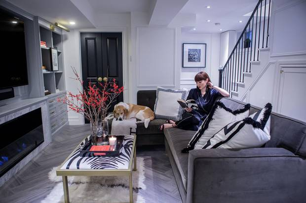 Aya McMillan is photographed withe her dog Bunny in her favourite room, the basement recreation room in her Toronto home.