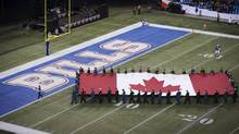 The Canadian flag is carried over the Buffalo Bills endzone before the Bills play the Atlanta Falcons in NFL action in Toronto, Sunday December 1, 2013. (Mark Blinch/THE CANADIAN PRESS)