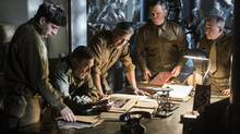 "From left, Sam Epstein, John Goodman, George Clooney, Matt Damon and Bob Balaban in a scene from ""The Monuments Men."" (Claudette Barius/AP)"
