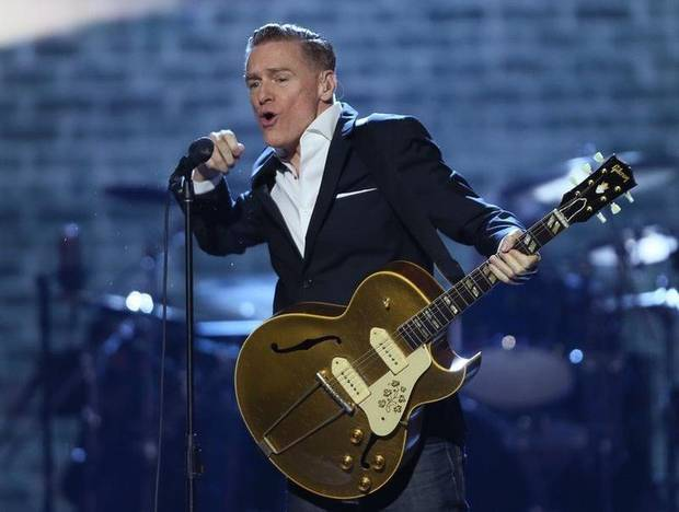 Canadian rocker Bryan Adams, top, performing at the 2016 Juno Awards, cancelled a tour date in Mississippi in protest over the state's new religous freedom bill.