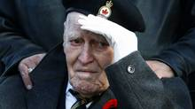 Canadian war veteran Ralph Preece, 89, salutes as he watches the Remembrance Day ceremony at the Royal Canadian Legion, Branch 101, in Toronto on Nov.11, 2009. (Nathan Denette/Nathan Denette/The Canadian Press)