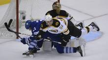 Toronto Maple Leaf Leafs James van Riemsdyk is knocked over by Boston Bruin Bruins Adam McQuaid during first-period NHL playoff action between the Toronto Maple Leafs and Boston Bruins on May 6 2013. (Fred Lum/The Globe and Mail)