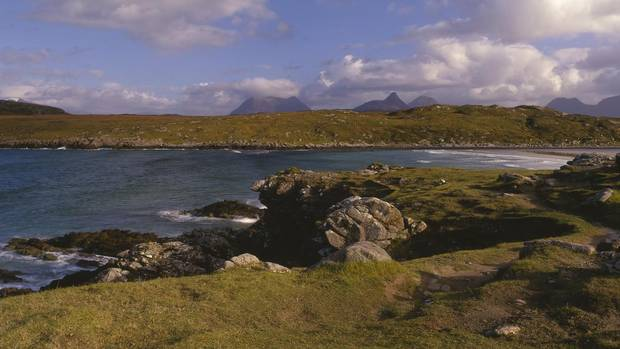 Looking over Achnahaird Bay, with a view to the mountains of the Inverpolly Nature Reserve, provides a glimpse of the rugged landscape and unforgiving shoreline of northern Scotland.