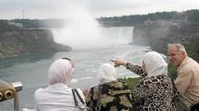 Crowds of tourists are photographed at the falls in Niagara Falls, Ont. July 30/2009. (Kevin Van Paassen/The Globe and Mail/Kevin Van Paassen/The Globe and Mail)