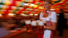 A waitress serves mugs of beer during the opening of Oktoberfest in Berlin. (FABRIZIO BENSCH/FABRIZIO BENSCH/REUTERS)