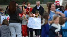 Prime Minister Stephen Harper is greeted by locals as he arrives in Whitehorse, Yukon on Sunday, August 18, 2013., Whitehorse is Harper's first stop on his annual northern Canada tour. (Sean Kilpatrick For The Globe and Mail)